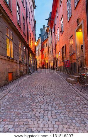 Gamla Stan narrow street illuminated at night, Stockholm, Sweden