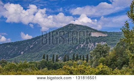 Green mountain under blue sky summer view