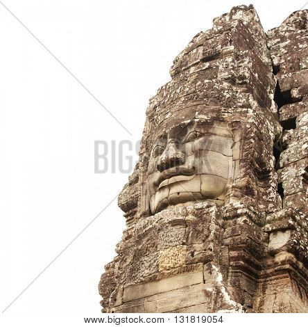 Giant stone face in Prasat Bayon Temple, famous landmark Angkor Wat complex, khmer culture, Siem Reap, Cambodia. Isolated on white background