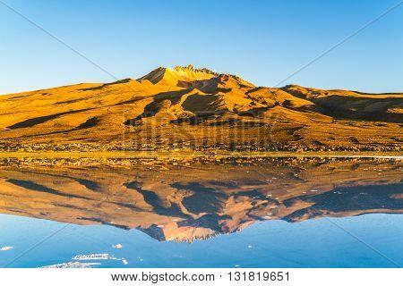 Dormant volcano at the salt lake of Solar De Uyuni in Bolivia