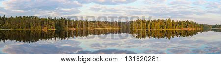 Morning landscape with reflections on the lake panorama