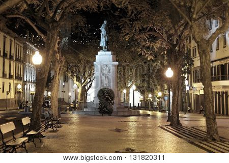 Night shot of the Arriaga avenue in Funchal and the monument in commemorates the Portuguese navigator Joao Goncalves Zarco