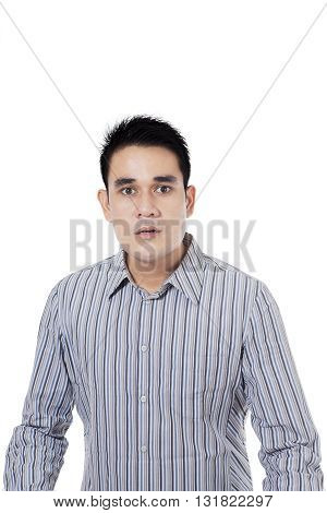 Portrait of young businessman with angry expression isolated on white background