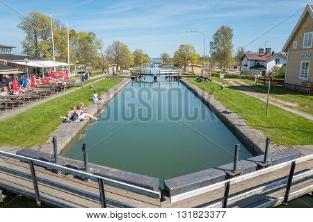 BERG, SWEDEN - MAY 6, 2016: Gota Canal during spring in Berg outside Linkoping. The canal contributes to a 390 km long waterway with 58 locks connecting the Swedish west coast with the east coast.