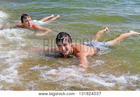 Two Happy Boys bathing in the Sea