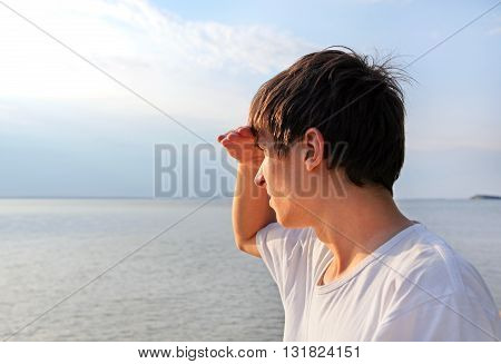 Young Man to gaze into the distance at the Seaside