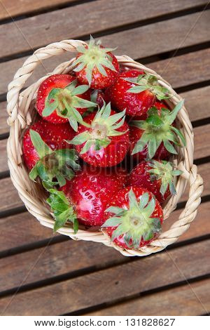 Small Basket Of A Strawberry Under Wooden Background