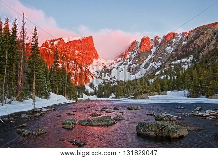 The peaks glow at sunrise at Dream Lake in Rocky Mountain National Park