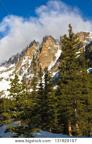 Clouds roll over the rugged peaks of Flattop Mountain in Rocky Mountain national Park