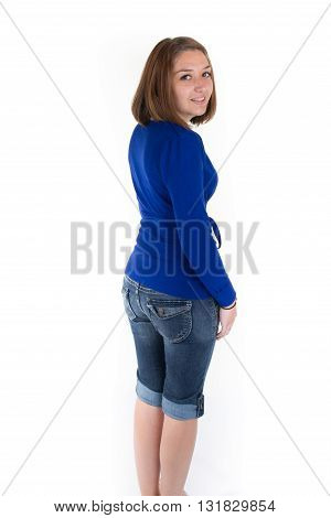 Pretty Casual Brunette Wearing Blue Denim Jeans And Blue Top