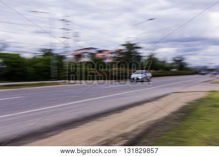 car Speeding in road , Thailand asia