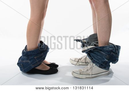 Legs Of Loving Couple. Man And Woman Who Undresses
