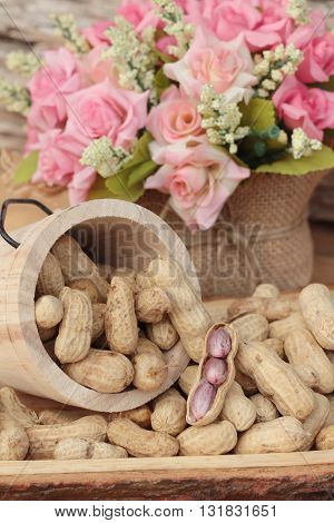 Peanut and boiled peanuts on wood background