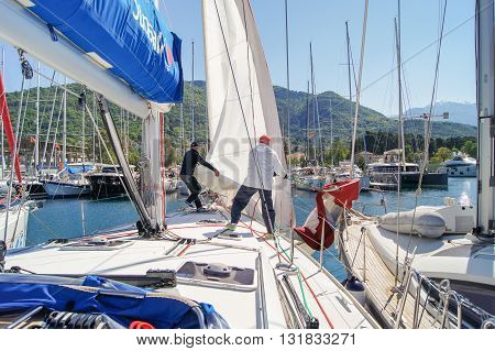 Tivat, Montenegro - 26 April, People on the boat pull up the sail, 26 April, 2016. Regatta