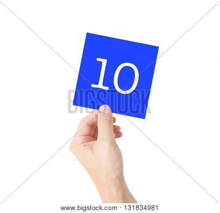 10 written on a card held by a hand