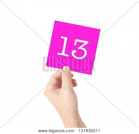 13 written on a card held by a hand