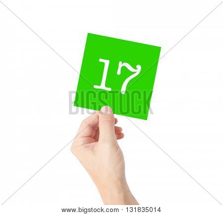 17 written on a card held by a hand