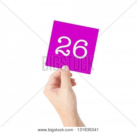 26 written on a card held by a hand