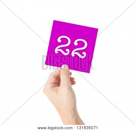 22 written on a card held by a hand