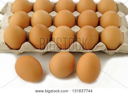 fresh raw eggs in package on background