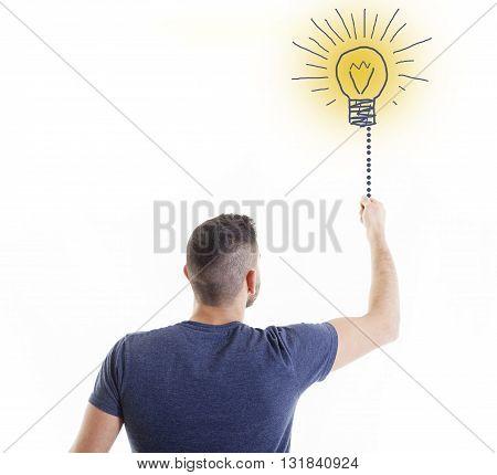 business man lights a doodle bulb idea