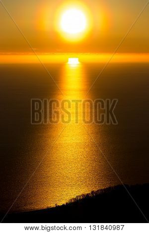 Golden sunset over the sea, the sun is reflected in water