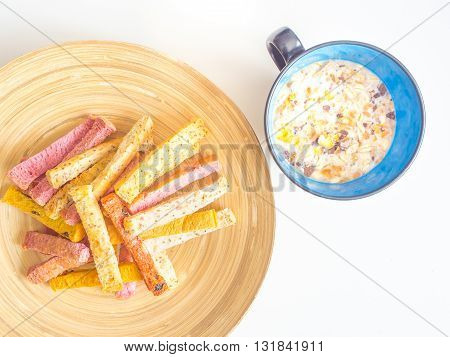 Organic and low fat crispy breads on wooden plate and cereal for breakfast