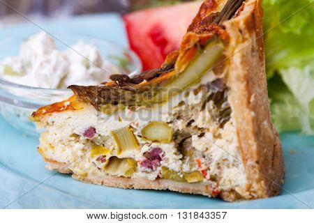 closeup of a quiche lorraine with salad