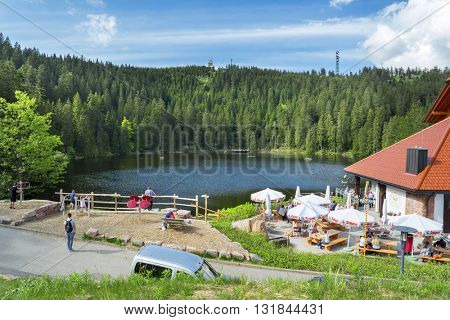 BADEN-BADEN, GERMANY - MAY 26, 2016: View of the lake Mummelsee. The Mummelsee is a 17-metre-deep lake at the western mountainside of the Hornisgrinde in the Northern Black Forest of Germany.