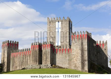 Guimaraes castle with the flag of the city, north of Portugal