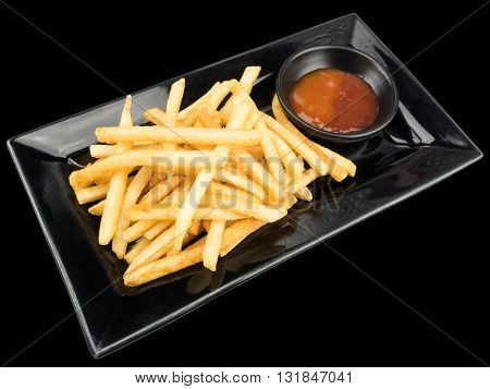 French fries with ketchup on a black plate isolated on the black background with clipping path