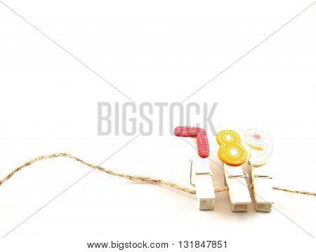 Wooden paper clips on brown string with seven eight nine popular telephone number for thai people believed in lucky number concept