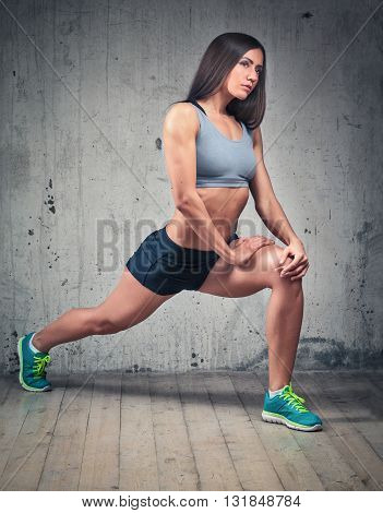 Sporty Female With Muscular Sexy Body Doing Fitness Lunge