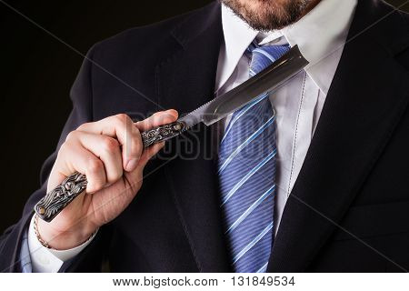 Businessman And Big Straight Razor