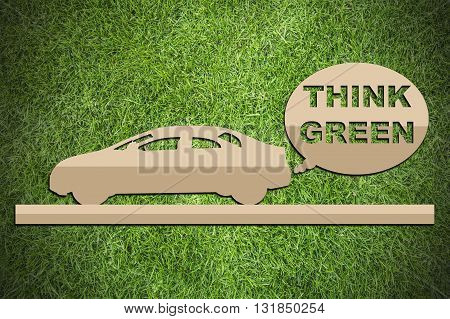 Paper cut of eco on green grass background