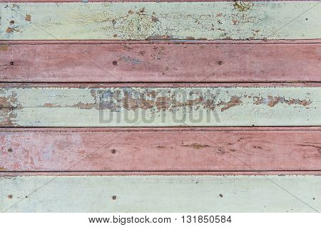 Vintage red and white wood background with peeling paint.