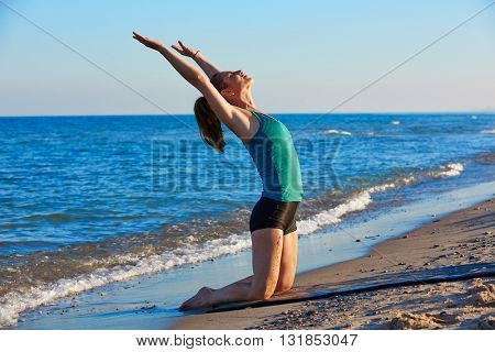 Pilates yoga workout exercise outdoor on the beach sand