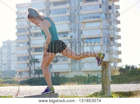 Runner girl having a rest and talking smartphone telephone outdoor building park