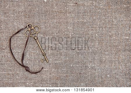 Vintage Background With Old Key On The Burlap
