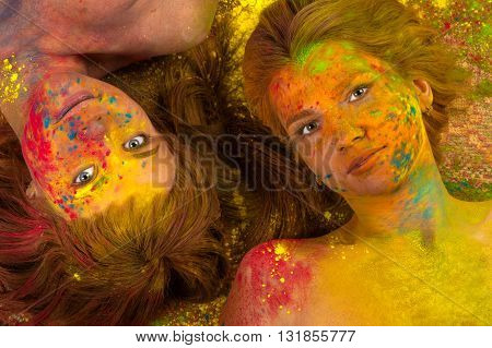 two attractive women in the colors of Holi