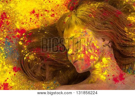 woman with yellow paint on face closeup