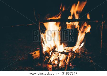 Cooking Kettle On Fire Flame Burning Outdoor. Travel Lifestyle Vacations Concept.