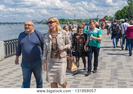 DNEPROPETROVSK UKRAINE - May 09 2016:People walking on the Dnepr river embankment during Victory Day celebrations at May 09 2016 in Dnepropetrovsk Ukraine