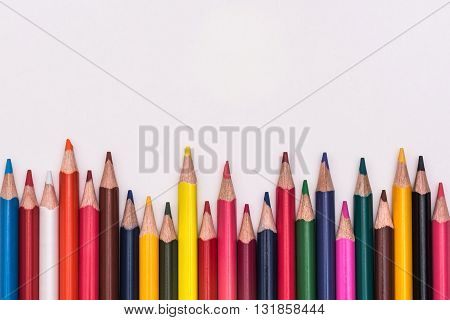 Colour Pencils Rainbow Lay On White Background