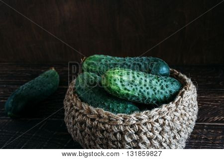 fragrant green cucumbers green cucumber on brown background basket made of jute