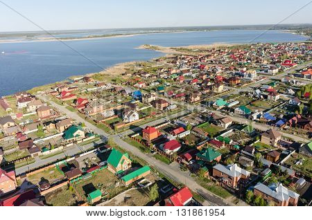 Borovskiy, Russia - May 16, 2016: Bird's eye view onto rural street in Borovskiy village. Tyumen region