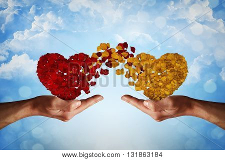 Two hands holding rose petal hearts. Romantic relationship concept. Attachment and love symbol giving and exchange of feelings and emotions of love.
