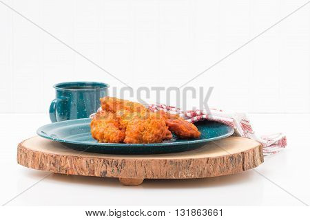 Spicy hot buffalo style chicken wings on a tin plate.