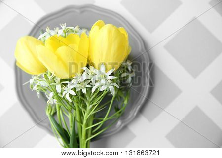 Bouquet of flowers on gray plate