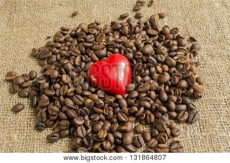 symbol heart on background Brown roasted coffee beans